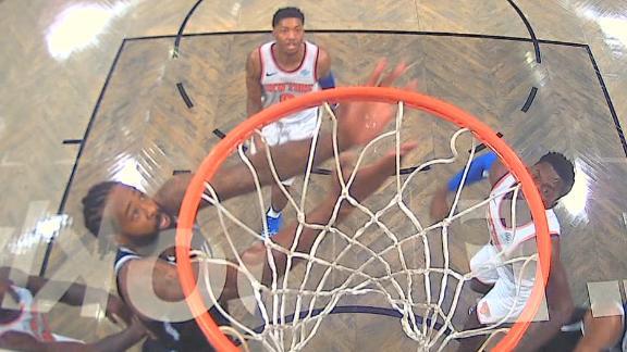 Jordan throws down reverse alley-oop