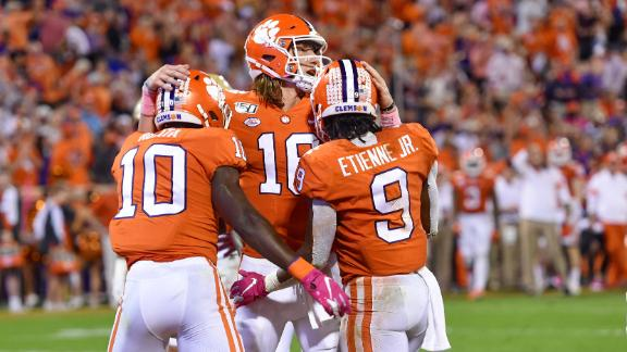 Lawrence tosses 3 TDs in Clemson's rout of BC