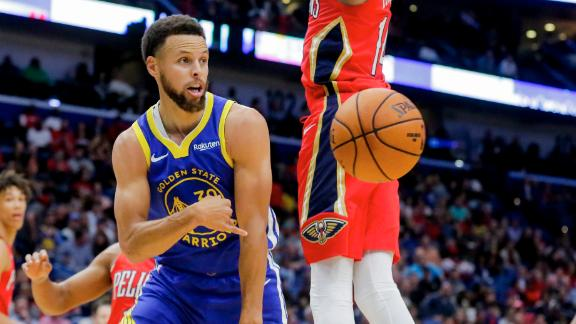 Curry drops 26 in Warriors' first win of season