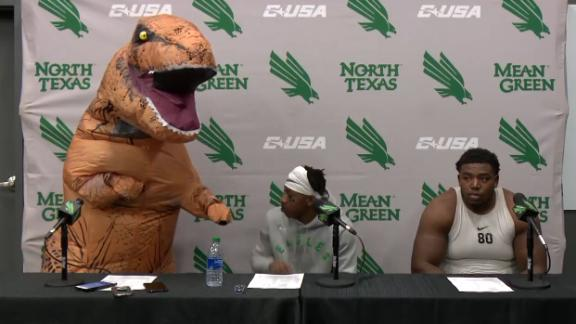 North Texas QB answers questions in a dinosaur costume
