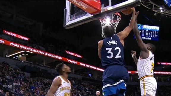 Towns rocks the rim on dunk over Paschall