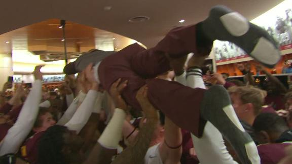 Fleck crowd-surfs after upset of Penn State