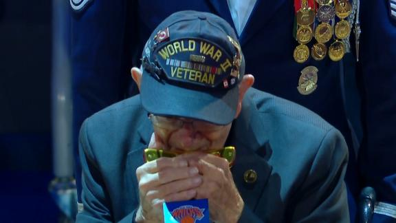 96-year-old veteran plays his harmonica for national anthem