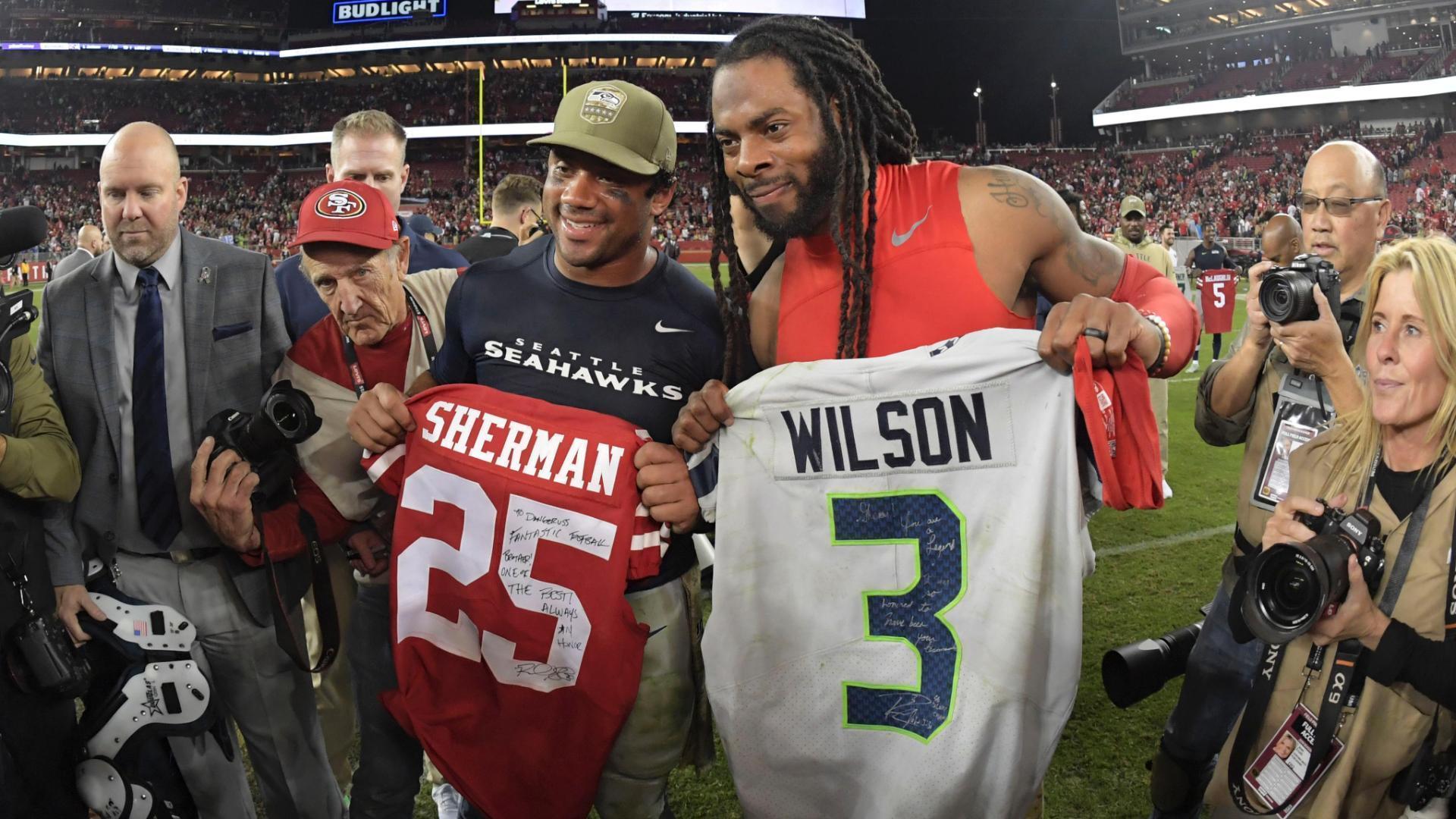 Wilson, Sherman exchange jerseys, hug it out