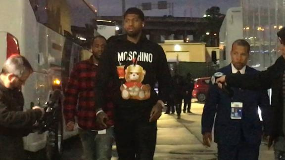 Paul George arrives for his debut with Clippers