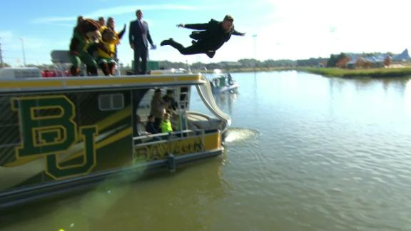 McAfee takes flight and belly flops into the river