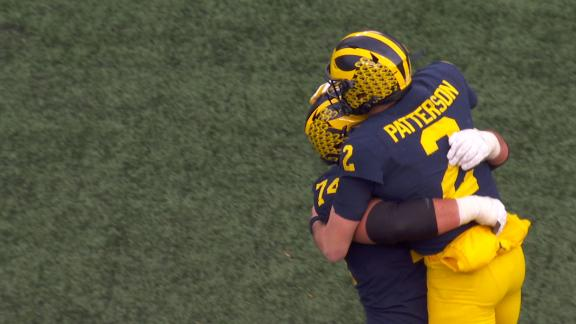 Michigan pours it on with late TD