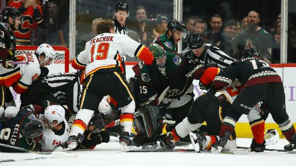 Coyotes, Flames goalies in middle of scrum