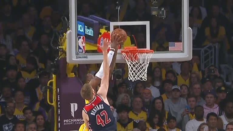 LeBron stares down Bertans after slam