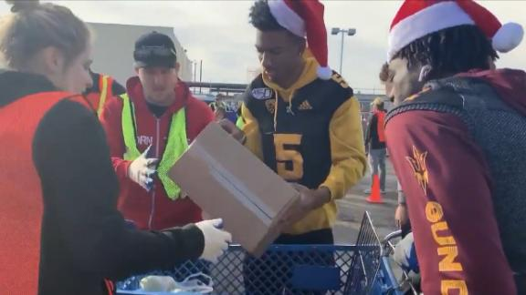 College football players give back to their communities around the holidays