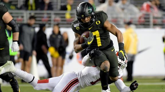 Verdell runs all over Utah as Oregon wins Pac-12 championship