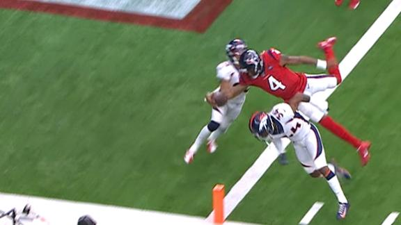 Watson gets airborne for a 6-yard TD