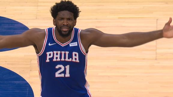 Embiid shimmies after acrobatic and-1