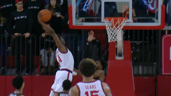 St. John's guard puts a defender on a poster