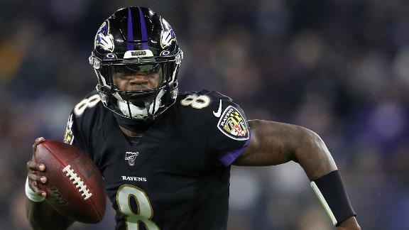 Jackson breaks Vick's single-season QB rushing record