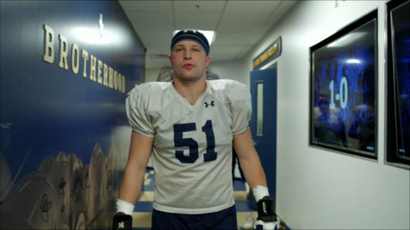 Navy football player leans on team after family tragedy