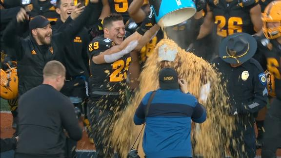 Herm Edwards gets a Frosted Flakes shower after Sun Bowl win