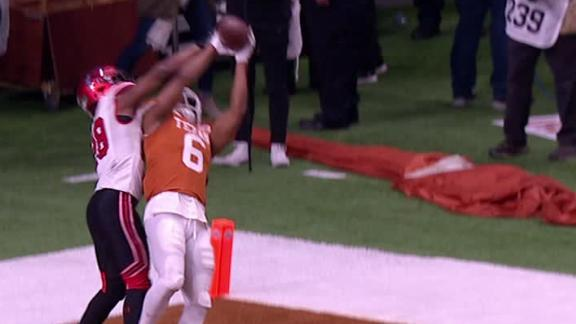 Texas' Duvernay secures TD grab despite interference