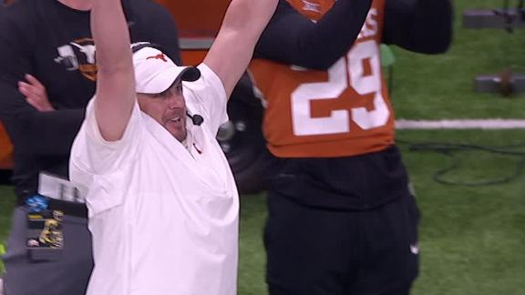 Texas' Herman celebrates after Ehlinger's pass overturned to INT