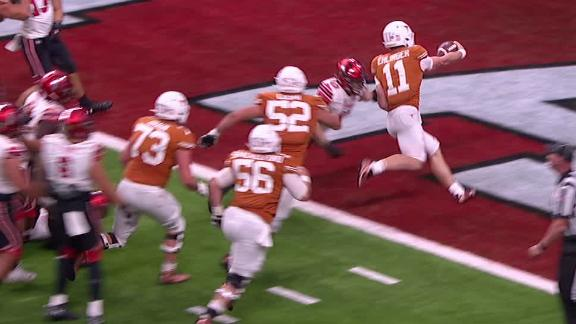 Ehlinger uses his legs to score the TD