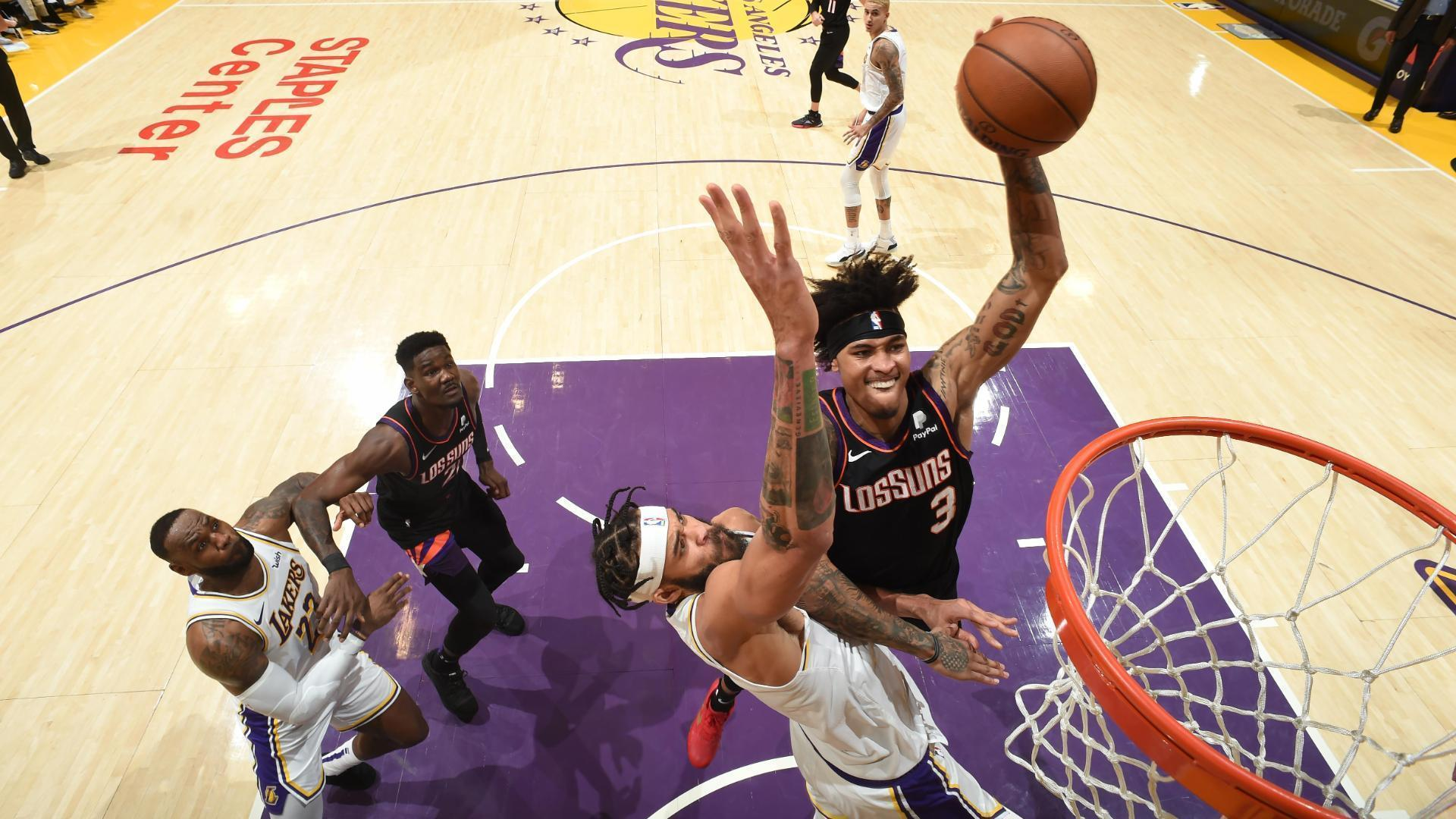 Oubre flexes after dunking on McGee