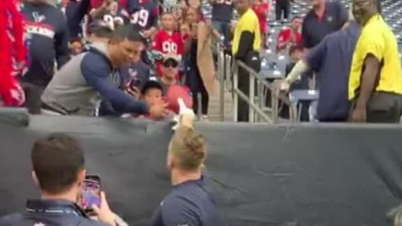 Watt plays catch with fans in the stands