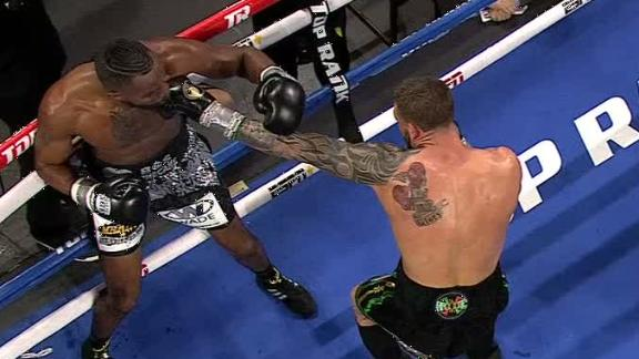 Smith tags Hart with a flurry of punches