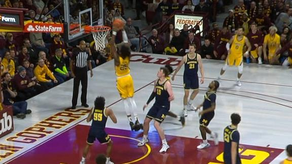 Minnesota's Oturu flushes lob pass from Carr