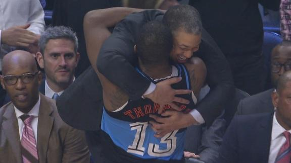 Thompson, Lue embrace after being reunited