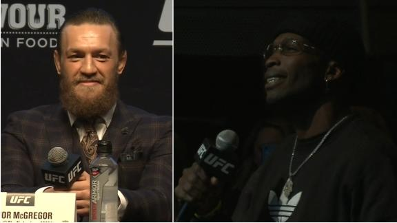Ochocinco asks McGregor a question at presser