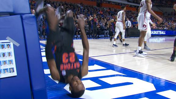 Florida's Lewis executes kip-up after foul