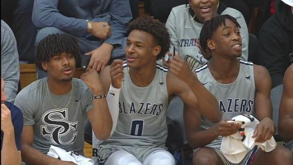 Bronny and Zaire dance on Sierra Canyon bench