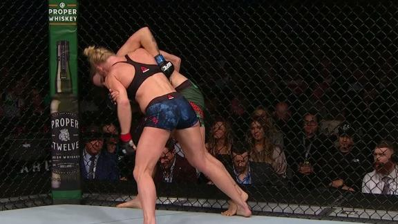 Holm dominates clinch in rematch with Pennington