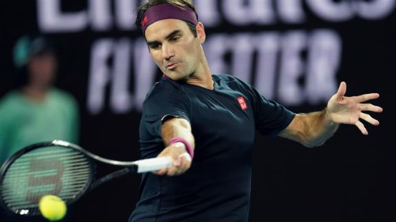 Federer beats Johnson in straight sets, advances to 2nd round