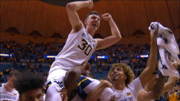 West Virginia walk-on hits 3, gets carried off court