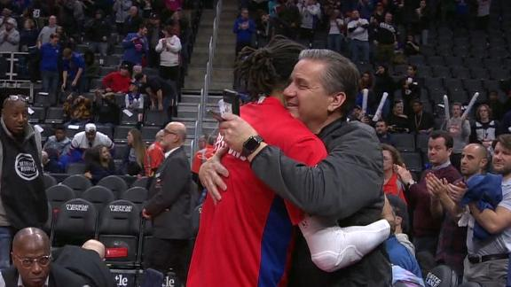 Rose gets a hug from Coach Cal after win