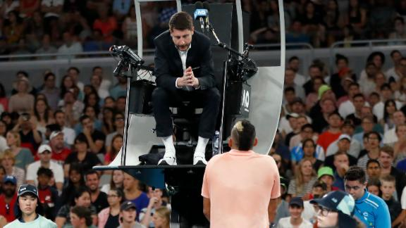 Kyrgios lashes out at umpire over injured hand