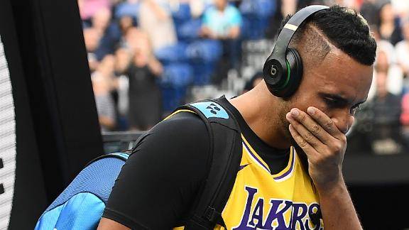Tearful Kyrgios enters court in Kobe jersey