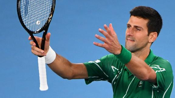 Djokovic eases past Raonic to set up Federer semifinal
