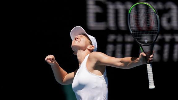 Halep cruises to semis