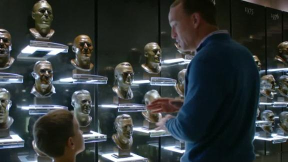 Peyton takes his son to the bust gallery at the Pro Football Hall of Fame