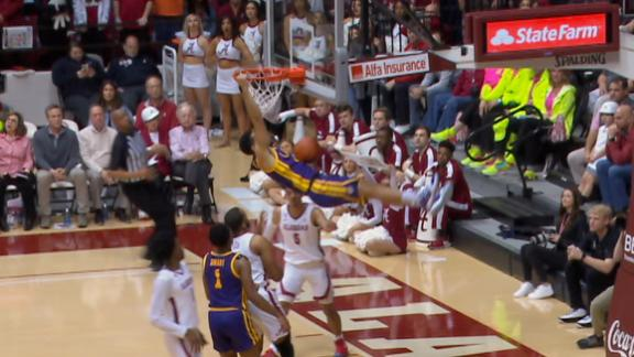 Mays hangs on rim after slam