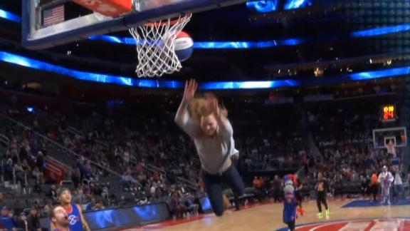 Pistons fan celebrates after trampoline basket fail