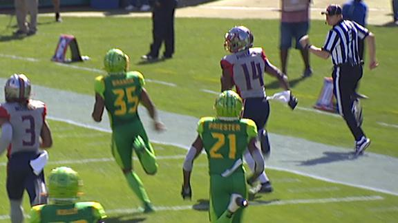 Walker avoids a sack and tosses 84-yard TD to Phillips