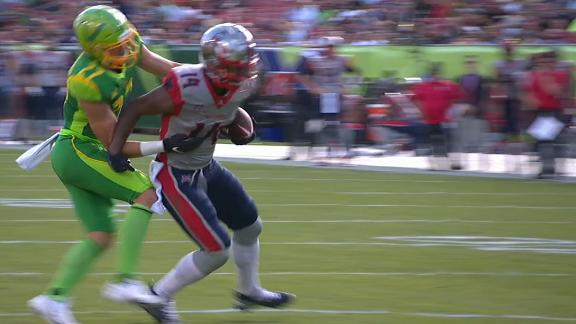 Phillips refuses to go down and spins into the end zone