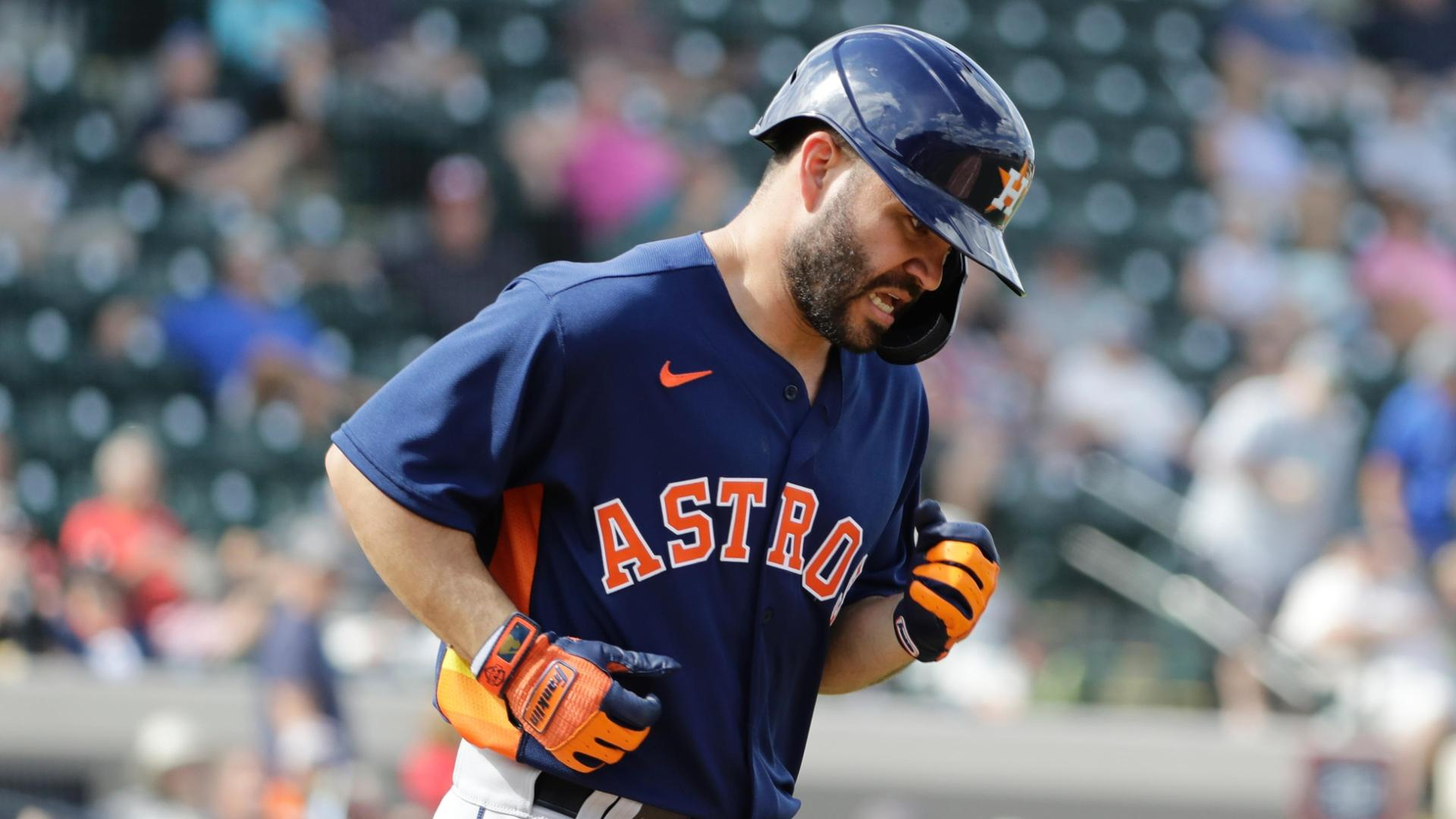 Altuve booed, hit by pitch in spring training debut