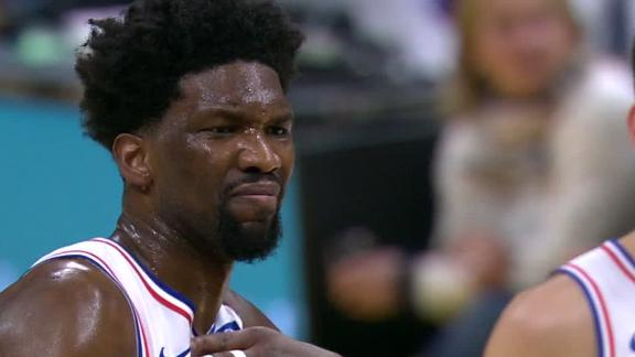 Embiid leaves game after wincing in pain