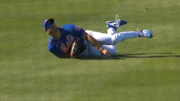 Tim Tebow takes a spill on would-be final out