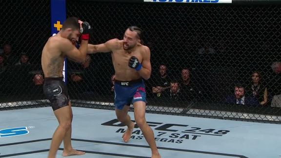 Phillips, Silva exchange leather in Round 1