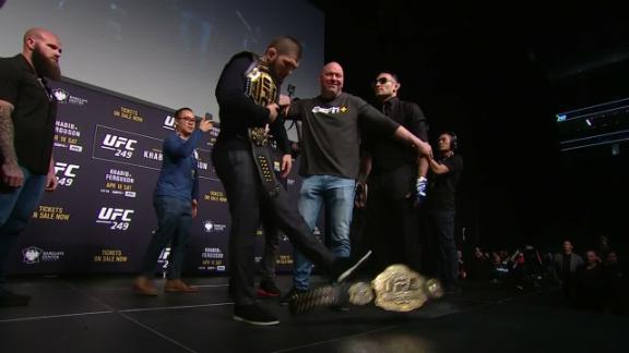 Khabib kicks Ferguson's belt off the stage